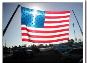 Blog. American flag with cross sun reflection.