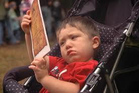 Blog. Unhappy boy in stroller. 11.12