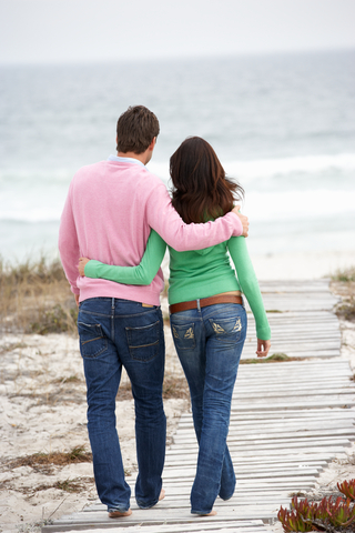 Blog. Couple arm in arm at shore. 8.13