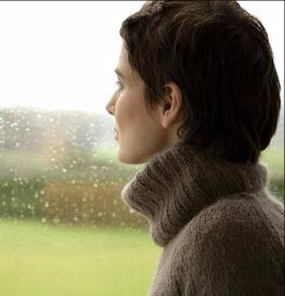 Blog. Thoughtful woman looking out window. 2.12