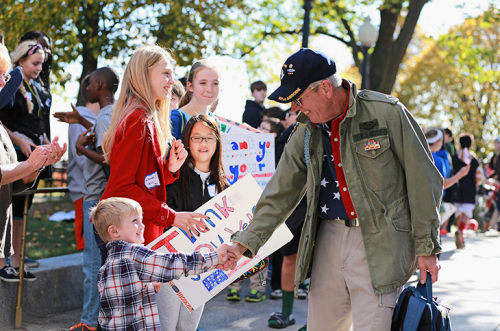 Blog. Veteran w. kids. signs.  2. 11.15